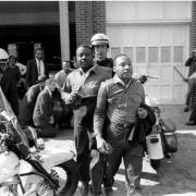 Ralph Abernathy, left, and Dr. King, are taken by a policeman after they led a line of demonstrators into the business section of Birmingham. (AP/Wide World)